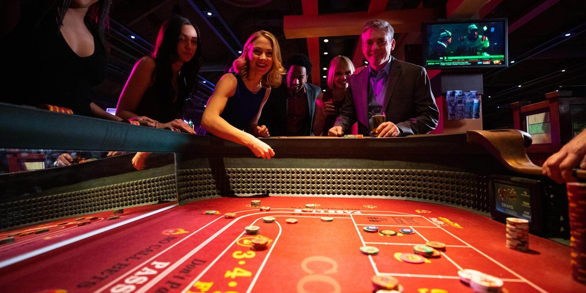 People enjoying a game at the casino.