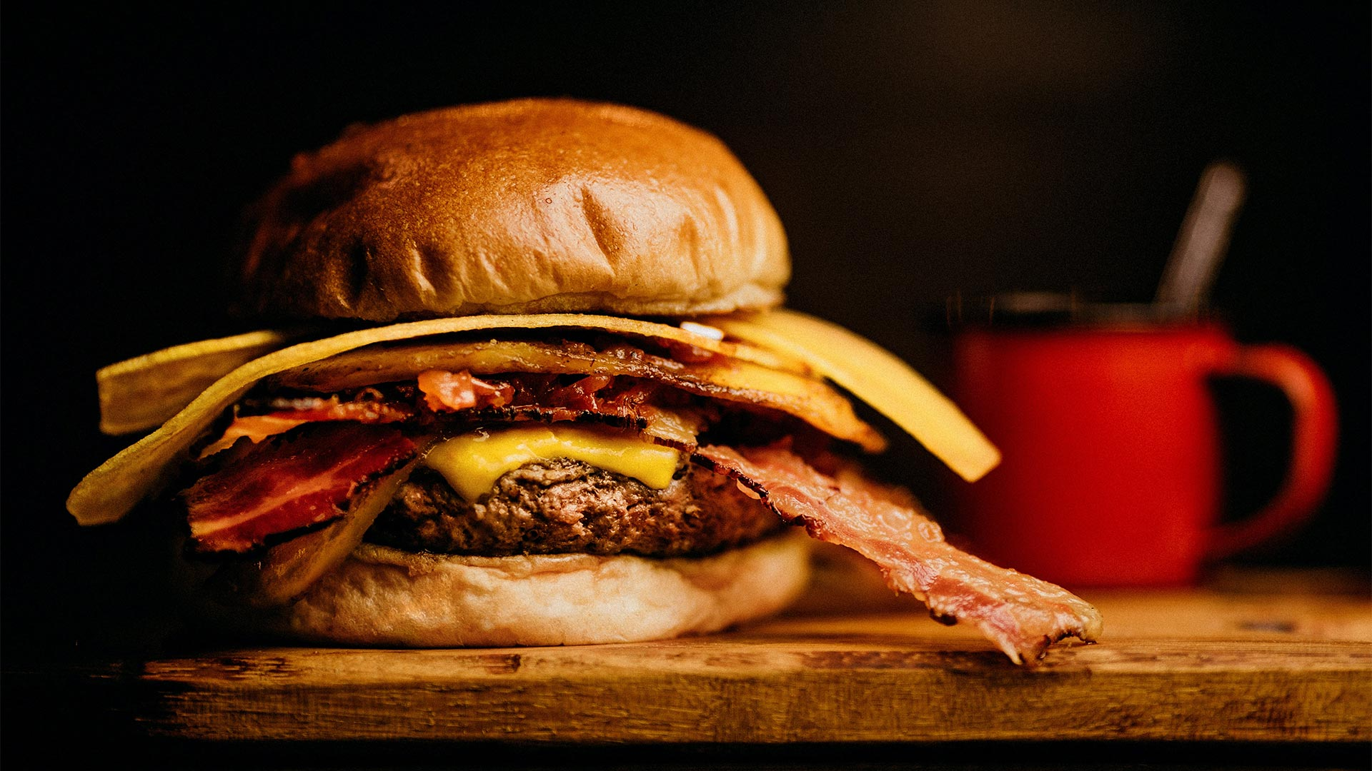 Mulligans hamburger and drink close up image