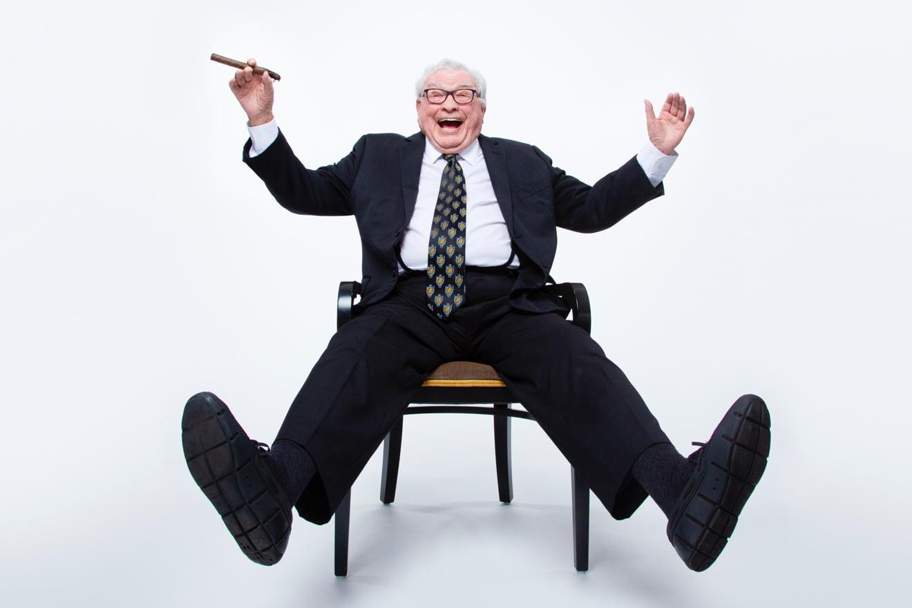 Joe Hardy with Cigar in Chair