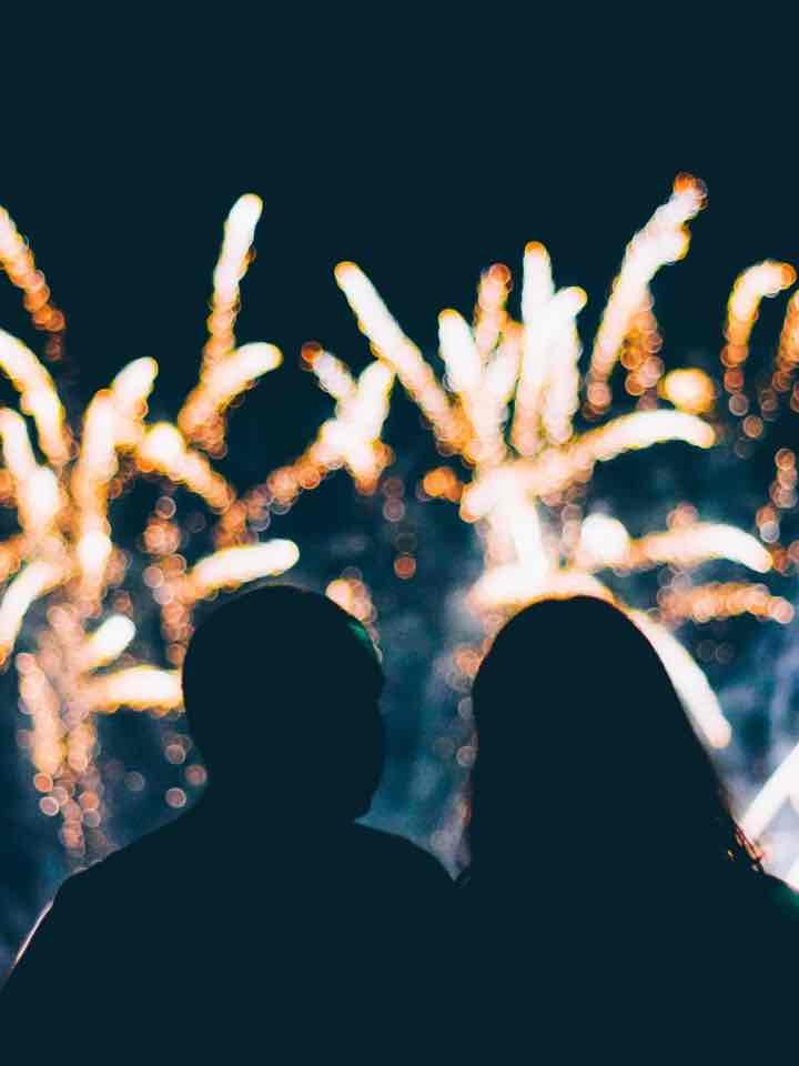 Two people watching fireworks